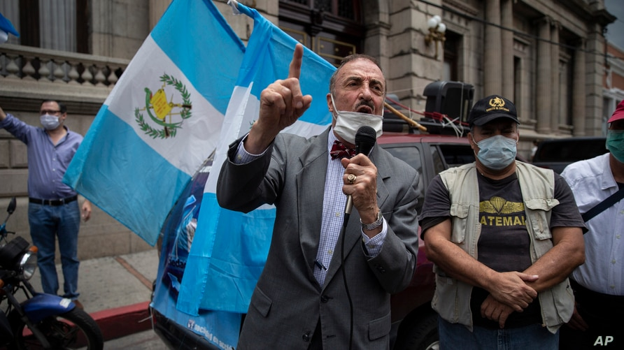 Anti-government activist and former congressman Fernando Linares speaks in front of the Congress building during a protest to…