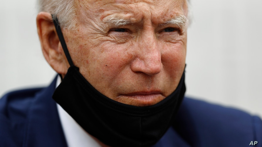 Democratic presidential candidate, former Vice President Joe Biden listens as he meets with small business owners, Wednesday,…