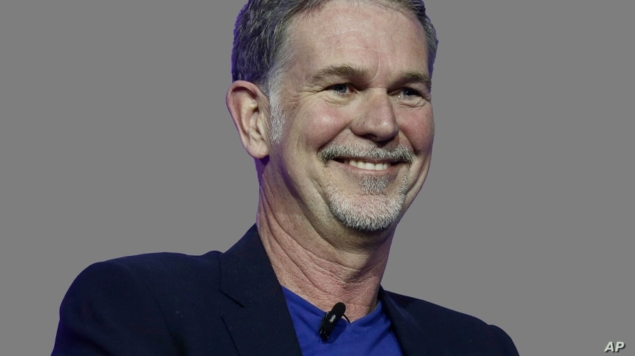 Reed Hastings headshot, Netflix founder and CEO, graphic element on gray