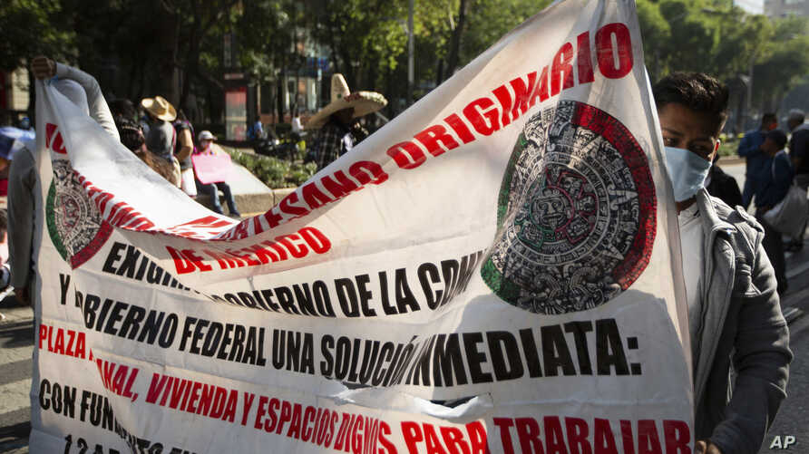 Mexican artisans block Paseo de la Reforma as they protest in Mexico City, Wednesday, June 10, 2020. Hundreds of artisan…