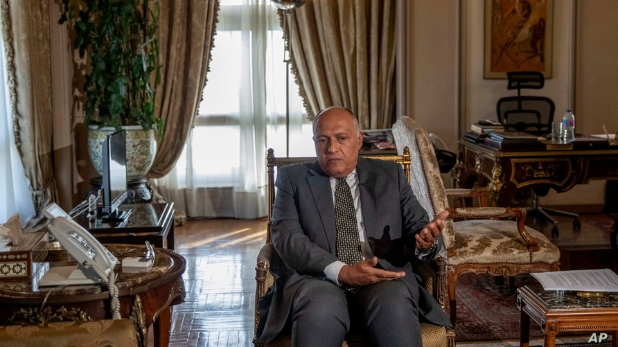 Egyptian Foreign Minister Sameh Shukry speaks during an interview with The Associated Press at his office, in Cairo, Egypt,…