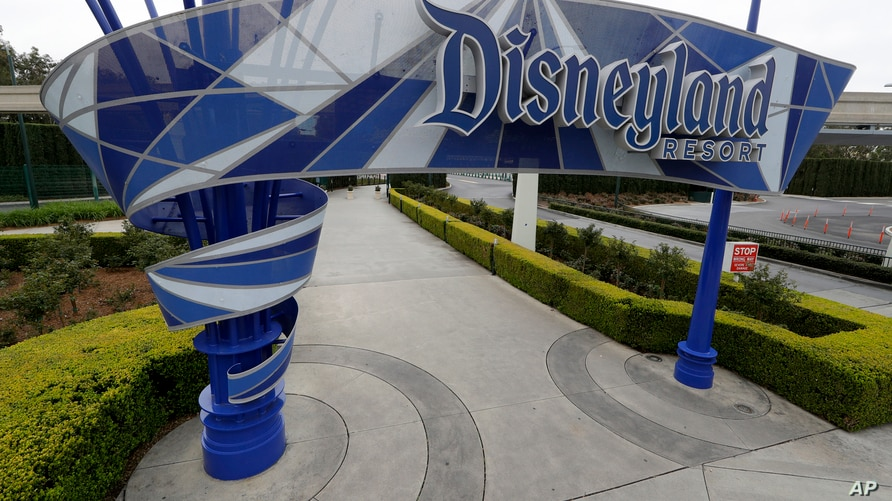 FILE - In this file photo taken Wednesday, March 18, 2020, one of the normally bustling entrances to the Disneyland resort is…
