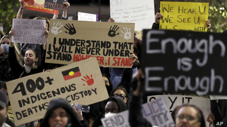 FILE - In this Tuesday, June 2, 2020 file photo protestors gather in Sydney to support the cause of U.S. protests over the…