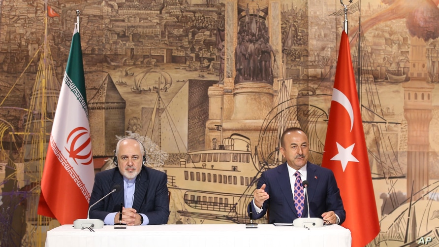 Turkish Foreign Minister Mevlut Cavusoglu, right, and Iran's Foreign Minister Mohammad Javad Zarif, speak to the media after…