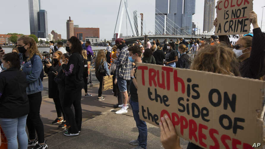 People take part in a demonstration in Rotterdam, Netherlands, Wednesday, June 3, 2020, to protest against the recent killing…