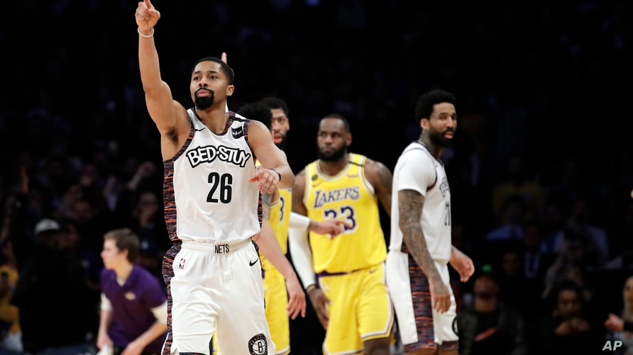 Brooklyn Nets' Spencer Dinwiddie (26) lobbies for a call to go in his team's favor during the second half of an NBA basketball…