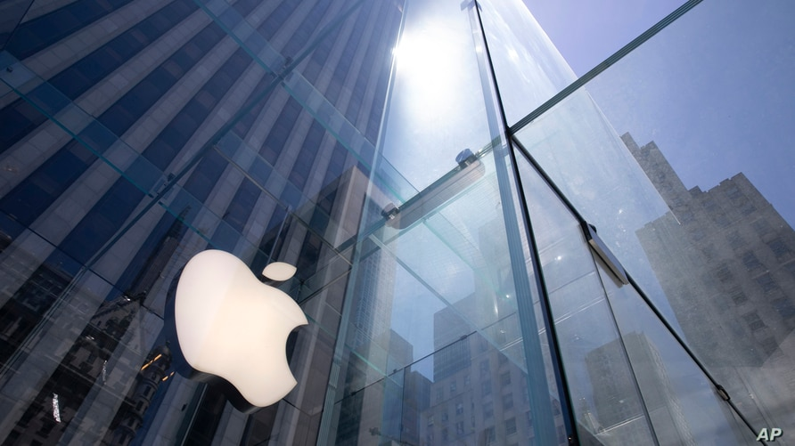 FILE - In this Tuesday, June 16, 2020 file photo, the sun is reflected on Apple's Fifth Avenue store in New York. A European…