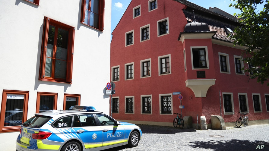 A police car stands guard in front of the house of deceased cleric Georg Ratzinger in Regensburg, Germany, Wednesday, July 1,…