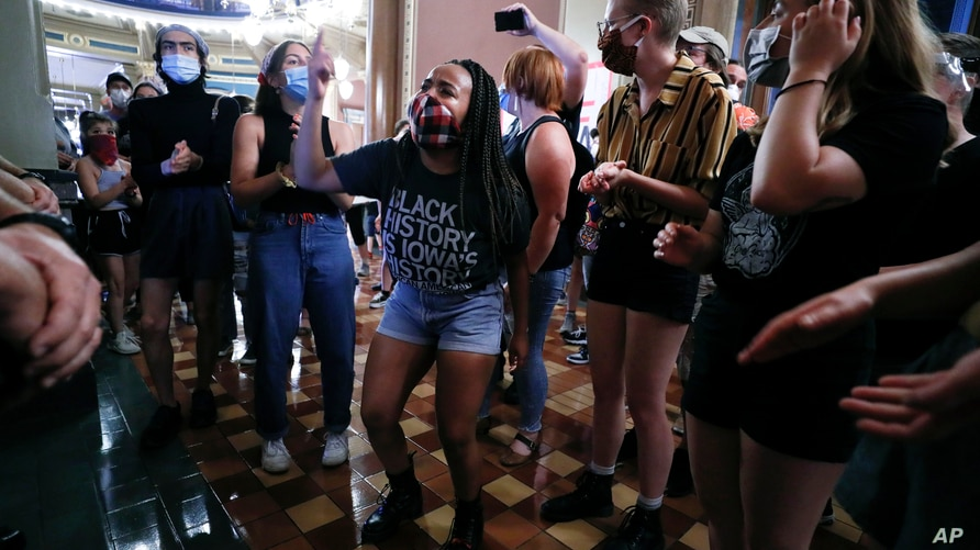 Black Lives Matter protesters rally outside Iowa Gov. Kim Reynolds' office, Monday, June 29, 2020, in Des Moines, Iowa. (AP…