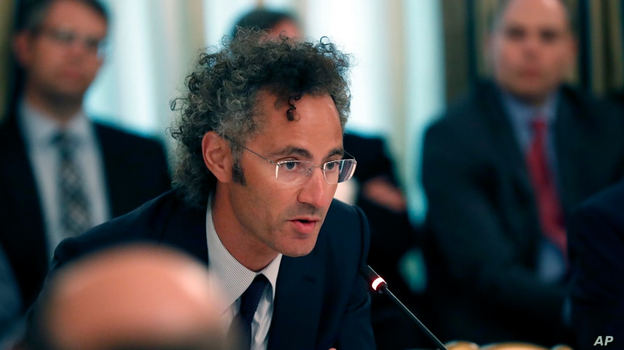 Alex Karp, Chief Executive Officer of Palantir, speaks during an American Technology Council roundtable in the State Dinning…