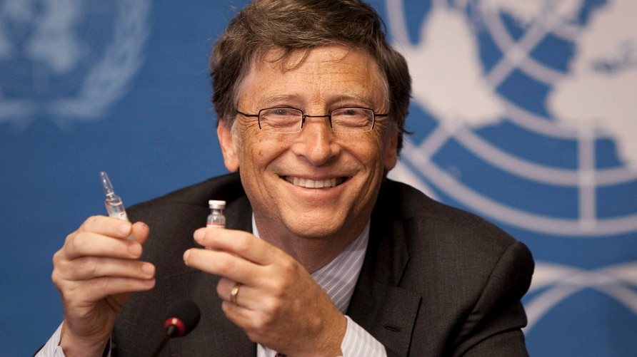 FILE - In this Tuesday, May 17, 2011 file photo, Microsoft founder Bill Gates holds a vaccine for meningitis during a news…