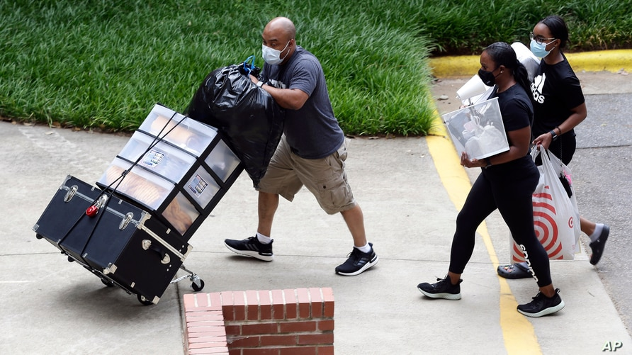 College students with the assistance of family begin moving in for the fall semester at N.C. State University in Raleigh, N.C.,…