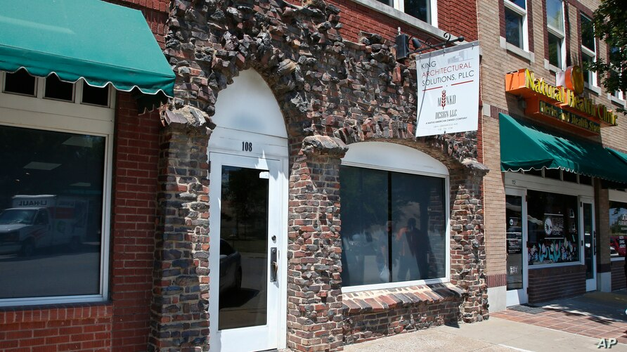 Burned bricks on a modern storefront are one of the few surviving reminders of the more than 30-block historic black district…