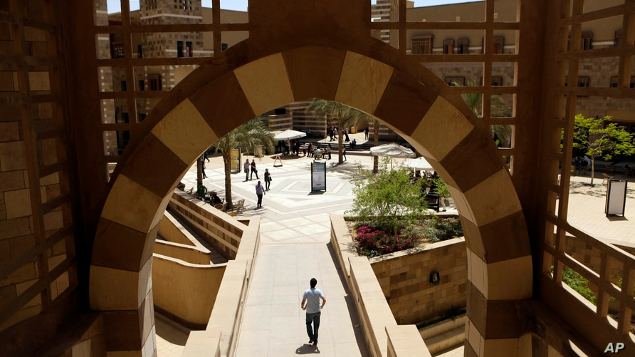 FILE - In this May 9, 2011 file photo, students walk in the campus of the American University in Cairo, in New Cairo, Egypt. In…
