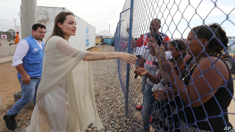 UNHCR's special envoy Angelina Jolie greets a group of Venezuelan migrants at an United Nations-run camp in Maicao, Colombia,…