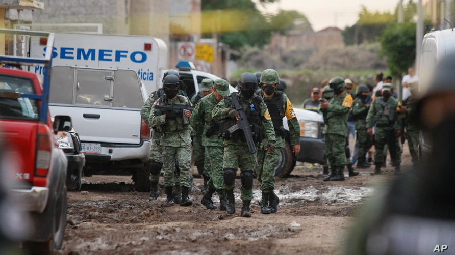 Members of the national guard walk near an unregistered drug rehabilitation center in Irapuato, Mexico, Wednesday, July 1, 2020…