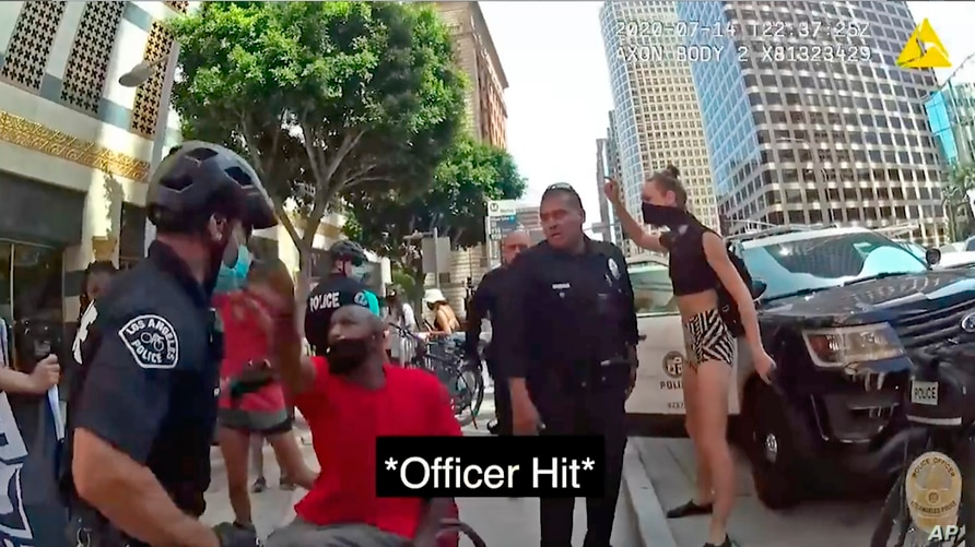 This Tuesday, July 14, 2020 photo from police body camera video released by the Los Angeles Police Department shows a…