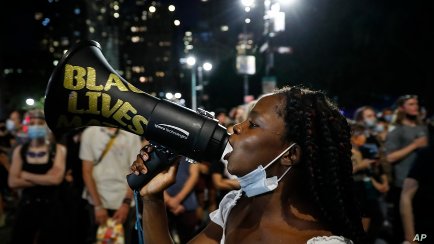 FILE - In this  June 30, 2020, file photo, protesters gather at an encampment outside City Hall in New York. Thousands of Black…
