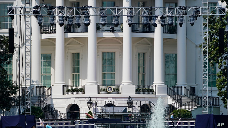 Workers construct staging on the South Lawn of the White House, Tuesday, Aug. 25, 2020 in Washington. President Donald Trump is…