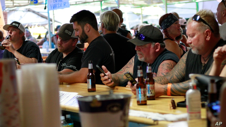 People crowded around bars in Sturgis, S.D., on Friday, Aug. 7, 2020 during the 80th anniversary of the Sturgis Motorcyle Rally…