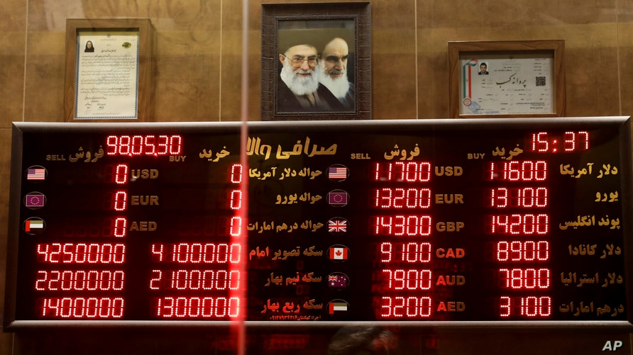 Various rates and prices for currencies and gold coins are displayed at an exchange bureau, in Tehran, Iran, Wednesday, Aug. 21…