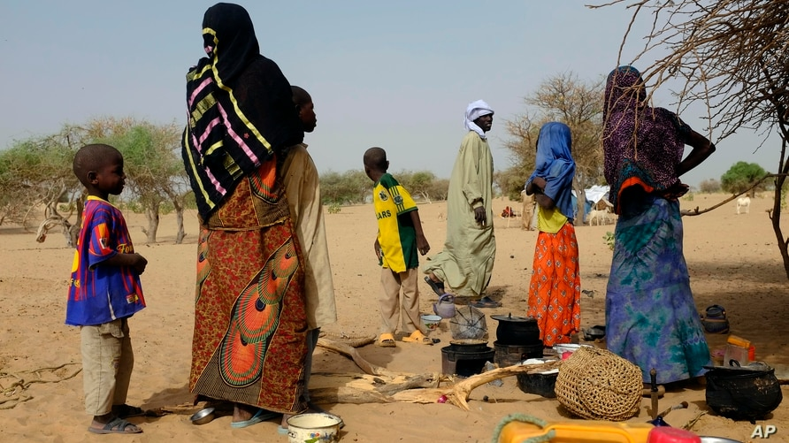 Chadians who fled the Lake Chad shore village of  N'Gouboua stand in their makeshift camp 20 kms (14 miles) from N'Gouboua,…