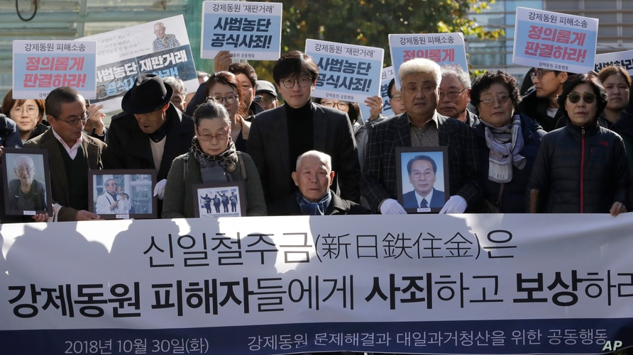 South Korean Lee Chun-sik, center, a 94-year-old victim of forced labor during Japan's colonial rule of the Korean Peninsula…