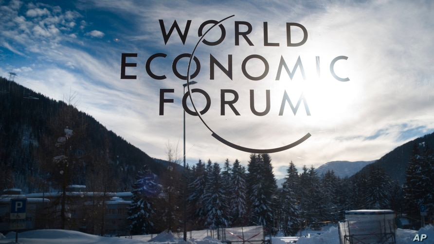The sign of the World Economic Forum, WEF, is displayed at an entrance door at the congress center at the eve of the meeting in…