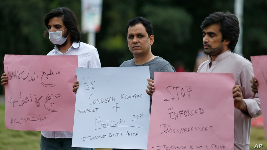 Pakistani journalists hold a demonstration to condemn the kidnaping of their colleague Matiullah Jan, in Islamabad, Pakistan,…