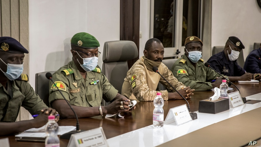 Col. Assimi Goita, center, who has declared himself the leader of the National Committee for the Salvation of the People, is…