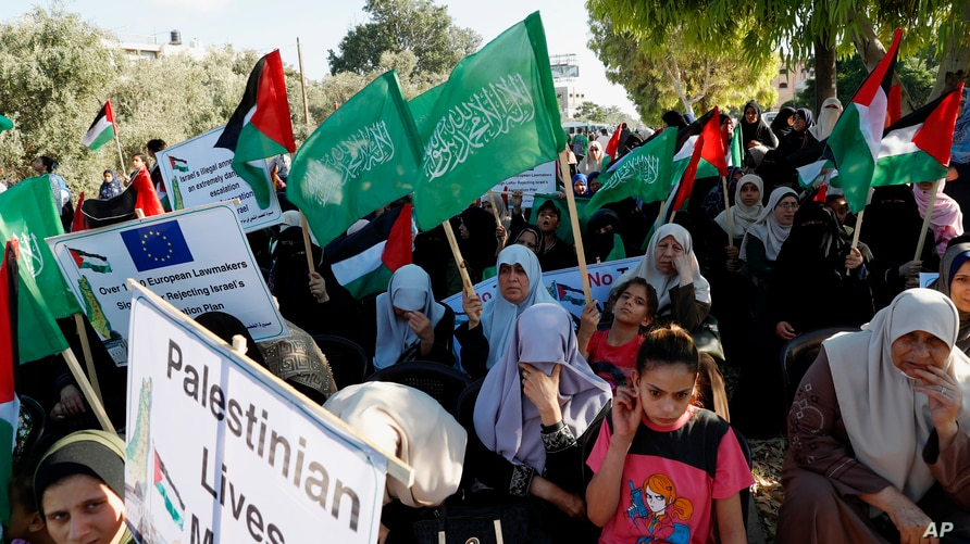 Women Hamas supporters attend a protest against Israel's plan to annex parts of the West Bank and U.S. President Donald Trump's…