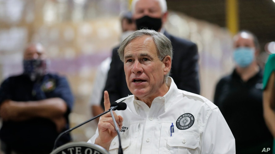 Texas Gov. Greg Abbott speaks to the media during a visit to a Texas Division of Emergency Management Warehouse filled with…