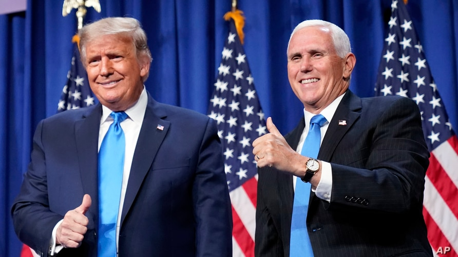 President Donald Trump and Vice President Mike Pence stand on stage during the first day of the 2020 Republican National…