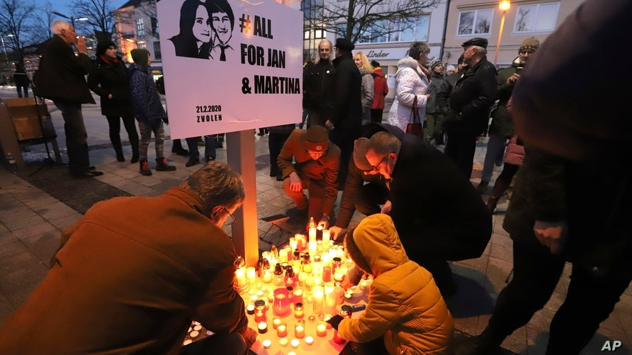 People attend a commemoration in Kosice, Slovakia, Friday Feb. 21, 2020, to mark the second anniversary of the slayings of an…