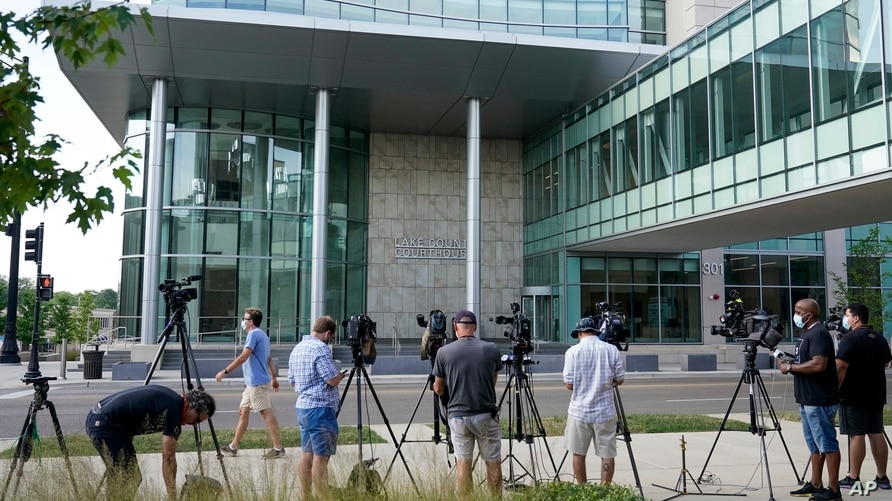 TV cameras set up outside the Lake County courthouse for the extradition hearing for Kyle Rittenhouse Friday, Aug. 28, 2020, in…