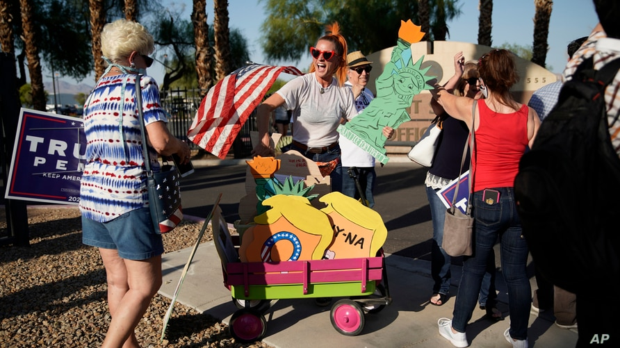People protest Tuesday, Aug. 4, 2020, in Las Vegas against a law signed this week by Nevada Gov. Steve Sisolak to mail ballots…