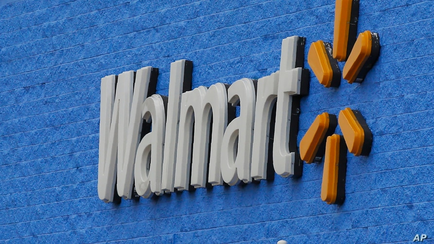 Signage is pictured at a Walmart store Tuesday, Aug. 4, 2020, in Oklahoma City. Walmart delivered strong profits and sales that…
