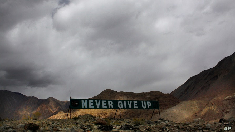 In this Sept. 14, 2017, file photo, a banner erected by the Indian army stands near Pangong Tso lake near the India-China…