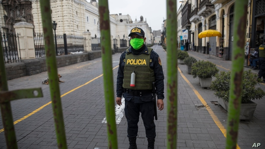 A police officer stands guard one block away from the Constitutional Court building in Lima, Peru, Thursday, Sept. 17, 2020…