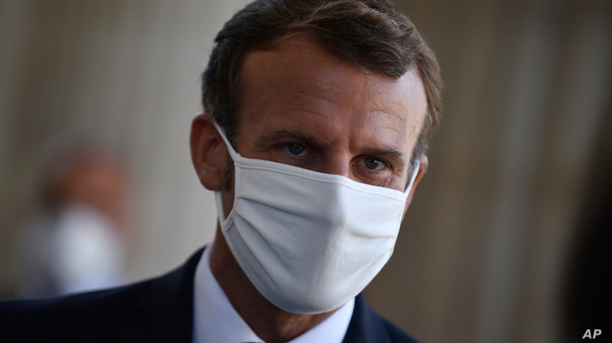 FILE - In this file photo dated Friday Sept. 4. 2020, French President Emmanuel Macron wears a mask during a ceremony to…