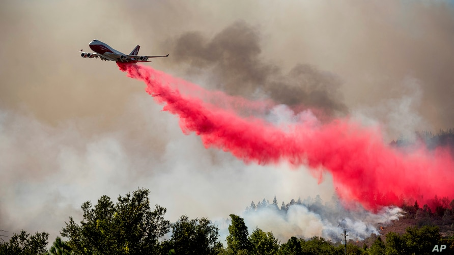 The Global Supertanker drops retardant while battling the Glass Fire in Napa County, Calif., on Sunday, Sept. 27, 2020. (AP…
