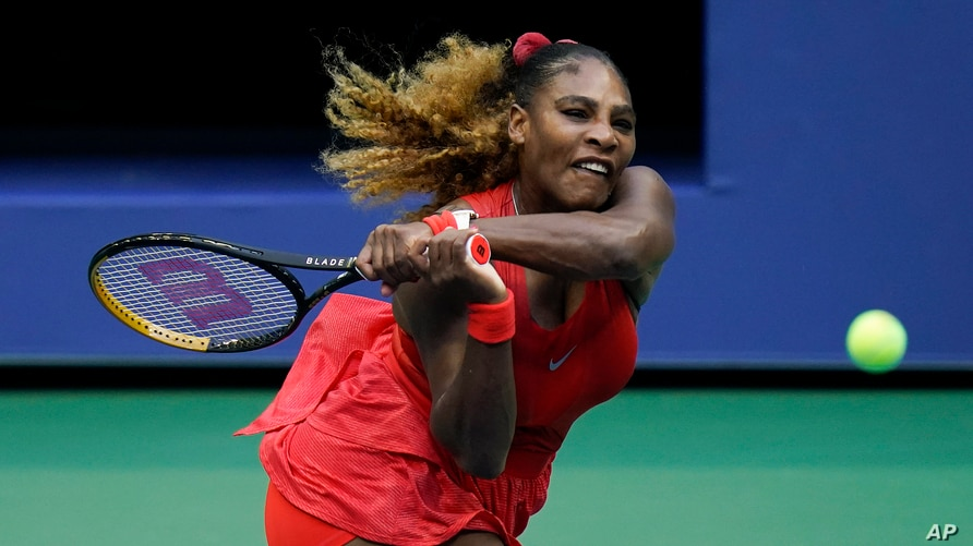 Serena Williams, of the United States, returns a shot to Kristie Ahn, of the United States, during the first round of the US…