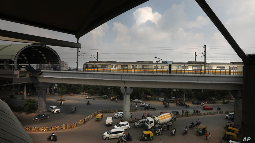 A Delhi metro train arrives at a station on the outskirts of New Delhi, India, Monday, Sept. 7, 2020. India's coronavirus cases…