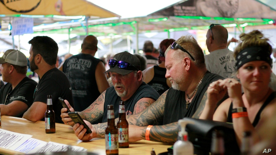 People congregates at One-Eyed Jack's Saloon during the 80th annual Sturgis Motorcycle Rally on Aug. 7, 2020, in Sturgis, South…