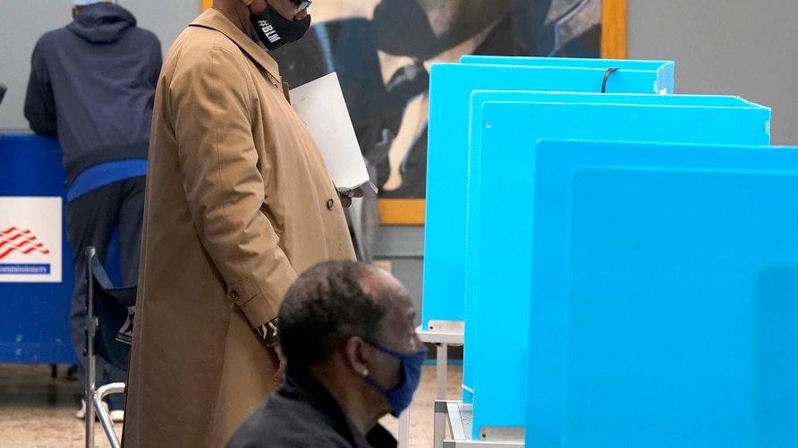Chicago residents participate Thursday, Oct. 15, 2020, in early voting at the Dr. Martin Luther King, Jr. Center in Chicago. …