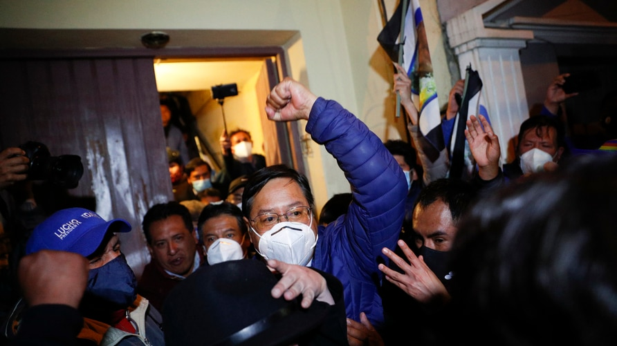 Luis Arce, presidential candidate for the Movement Towards Socialism (MAS) party, is surrounded by supporters after holding a…