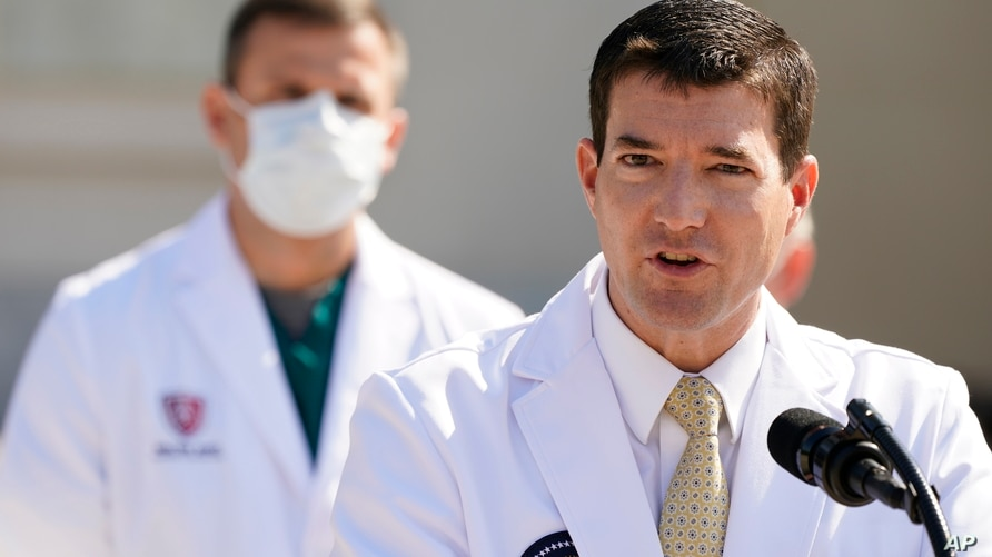 Dr. Sean Conley, physician to President Donald Trump, briefs reporters at Walter Reed National Military Medical Center in…
