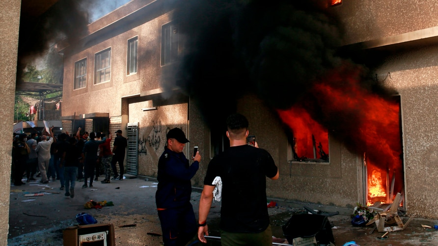 The headquarters of Kurdish Democratic Party burn during a protest by pro-Iranian militiamen and their supporter in Baghdad,…
