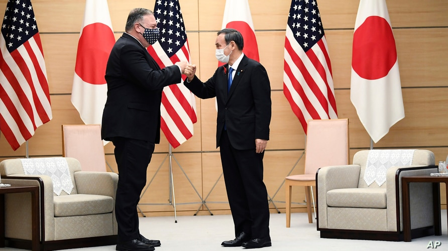 Japan's Prime Minister Yoshihide Suga, right, and U.S. Secretary of State Mike Pompeo pose as they attend a meeting at the…