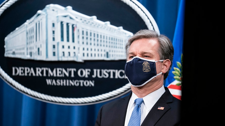 FBI Director Christopher Wray listens during a virtual news conference at the Department of Justice, Wednesday,  Oct. 28, 2020…